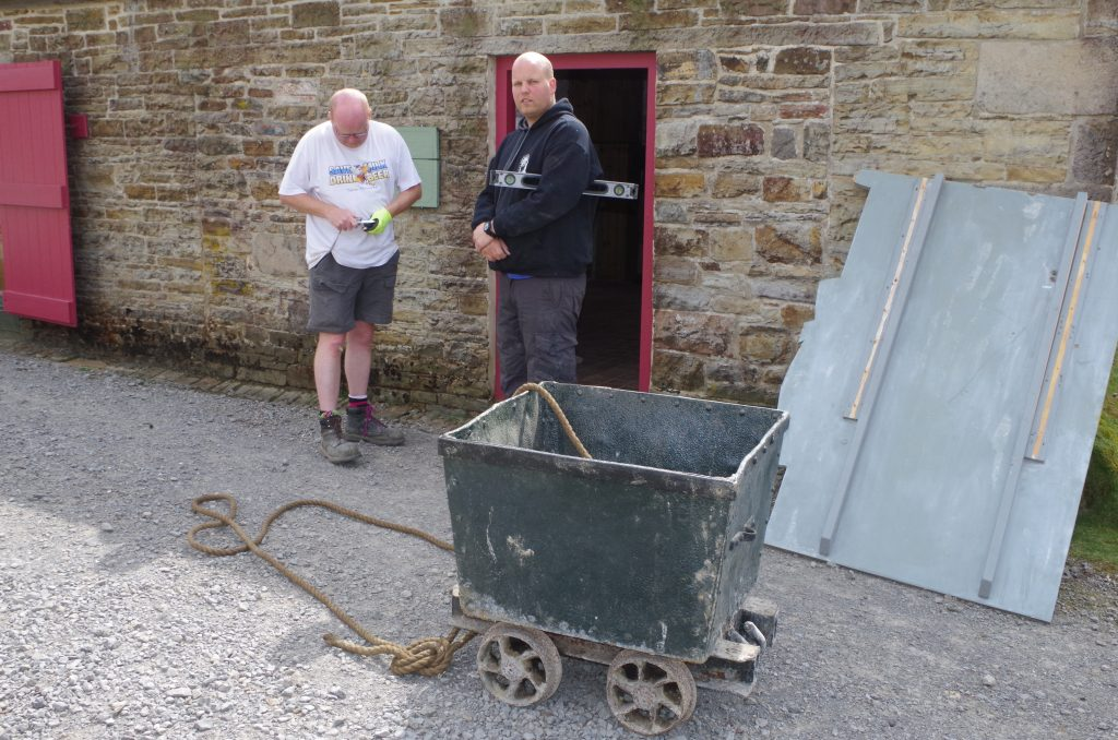 Peter and Martyn moving the small wagon into The Workshop